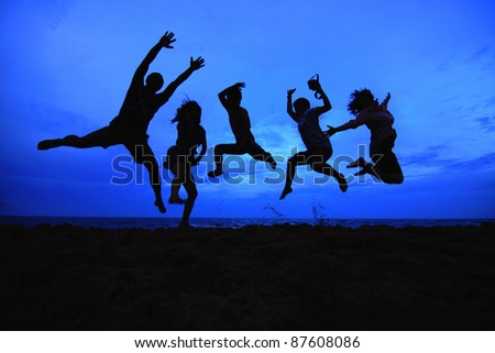 jumping team at sunset time as silhouette background