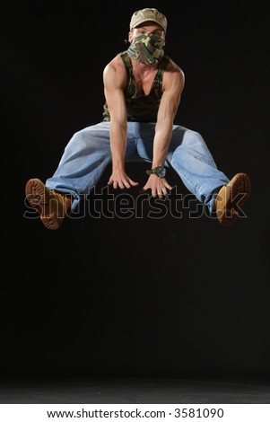 jumping up krump style dancer - stock photo