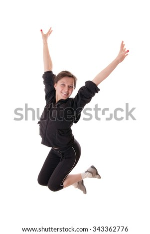 Jumping woman in a black tracksuit, isolated