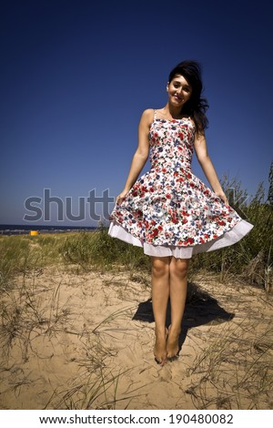 jumping woman in the beach - stock photo