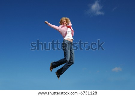 Jumping woman on a sunny day against a blue sky