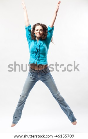 Jumping woman on White Background - stock photo