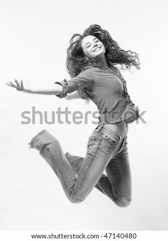 Jumping woman on White Background. Black and White - stock photo