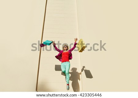 jumping woman shopping bags