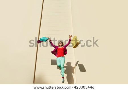jumping woman shopping bags - stock photo