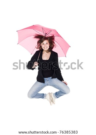 Jumping woman with umbrella isolated on white background - stock photo