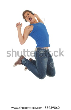 jumping young handsome man in headphones, on the white background - stock photo