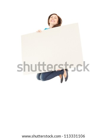 jumping young woman with blank sign, full length, white background - stock photo