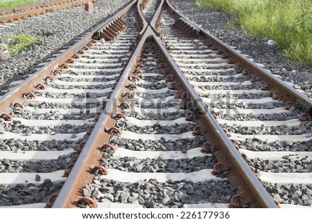 Junction of the railway tracks, switching the train during the journey. - stock photo