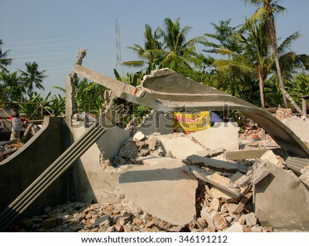 June 19, 2006: A concrete house lies in ruins after it was destroyed by the May 29 2006 Yogyakarta earthquake that measured 5,7 on the Richter Scale in Yogyakarta Province, Java, Indonesia. - stock photo