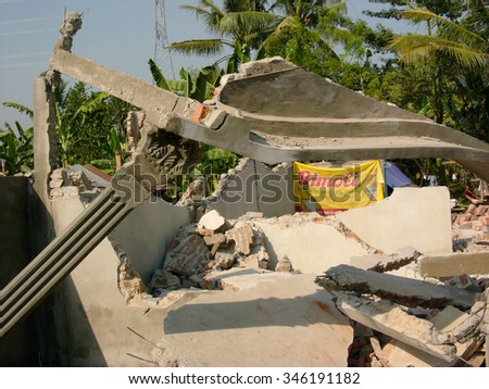 June 19, 2006: A house lies in ruins after it was destroyed by the May 29 2006 Yogyakarta earthquake that measured 5,7 on the Richter Scale, on June 19, 2006 in Yogyakarta Province, Java, Indonesia. - stock photo