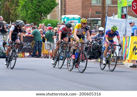 JUNE 15, 2014: Cyclists chase race leader at final stage of 2014 North Star Grand Prix in Stillwater, Minnesota. About 300 top pro cyclists from around the world compete in the prestigious event.  - stock photo