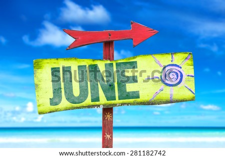 June direction sign with beach background - stock photo