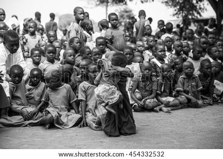 June 23, 2016: Soroti, Unganda. School children gather for an assembly to greet visitors from Drop in the Bucket - stock photo