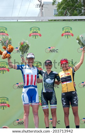 JUNE 15, 2014: Women winners podium at final stage of 2014 North Star Grand Prix in Stillwater, Minnesota. About 300 top pro cyclists from around the world compete in the prestigious event.  - stock photo