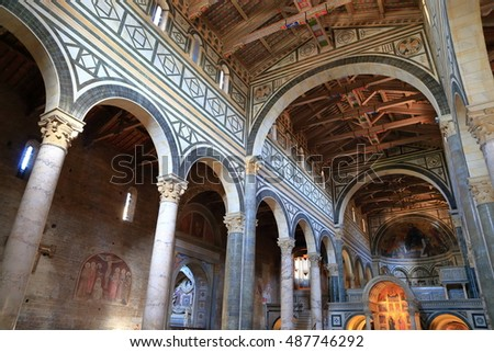 June 30, 2016: Wooden ceiling and Romanesque arches inside the Basilica of San Miniato al Monte, Florence, Tuscany, Italy