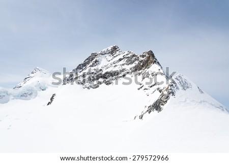 Jungfrau Alpine Alps mountain landscape at Jungfraujoch, Top of Europe Switzerland - stock photo