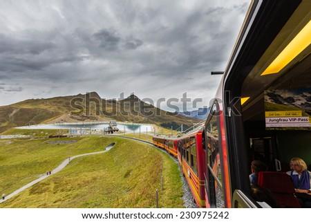JUNGFRAU, SWITZERLAND - NOV 15, 2014: The Jungfrau railway is a metre gauge rack railway which runs 9 km from Kleine Scheidegg to the highest railway station in Europe at Jungfraujoch. - stock photo