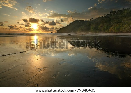 Jungle beach in Costa Rica at sunset, Manuel Antonio Park - stock photo
