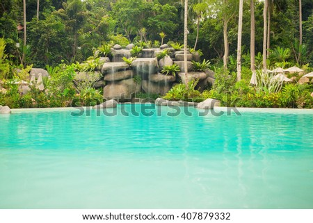 Jungle landscape with wonderful blue lagoon and flowing turquoise water cascade waterfall at deep tropical rain forest, Thailand - stock photo