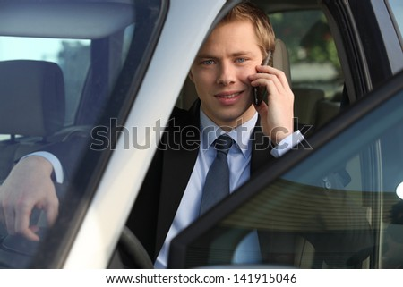 junior executive driving luxury car - stock photo