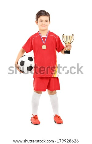 Junior football player holding a golden cup isolated on white background - stock photo