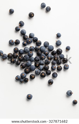Juniper berries on white background, close-up