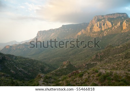 Juniper Canyon and towering Chicos Mountains at sunrise - stock photo