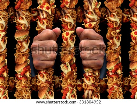 Junk food addiction and eating unhealthy lifestyle concept with a prison bars shaped made of  fried chicken hamburgers and hot dogs processed meat products and french fries as a symbol. - stock photo