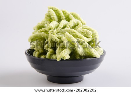 Junk food, green peas snack on a background - stock photo