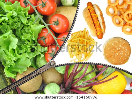 Junk food vs fruit and vegetables  - stock photo