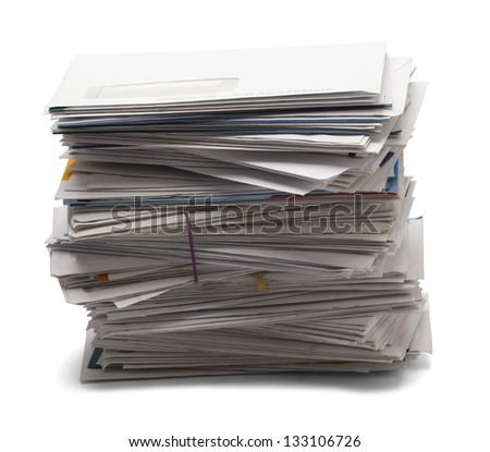 Junk mail stacked high of unpaid bills from the side view, isolated on a white background.