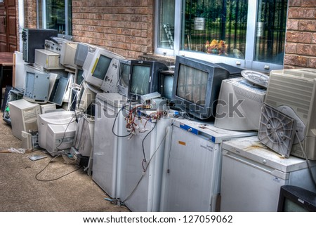 Junk PCs, monitors and fridges ready for land fill - stock photo