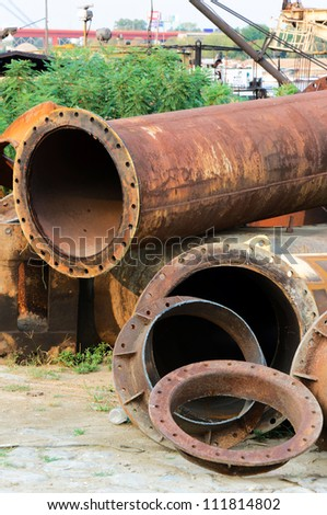 Junk yard with old pipes - stock photo