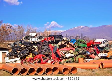 Junkyard full of smashed cars - stock photo