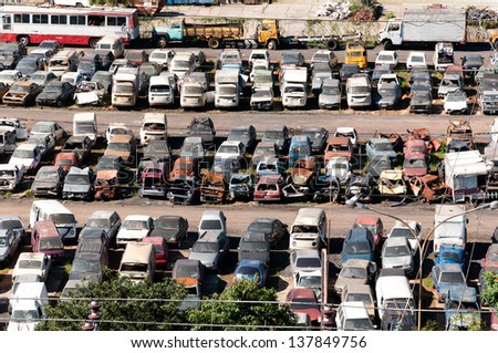Junkyard with cars abandoned and rusting - stock photo