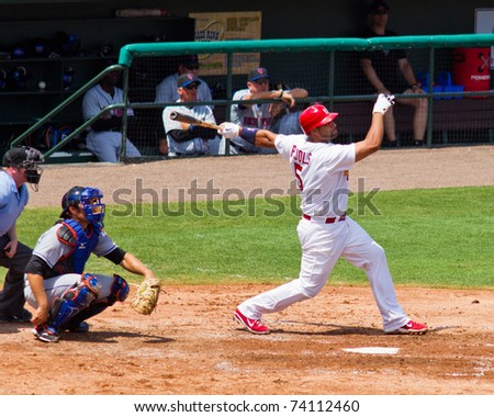 JUPITER, FL USA - MAR. 27: Cardinal first baseman Albert Pujols bats during the New York Mets vs. St. Louis Cardinals spring training game March 27, 2010 in Jupiter, FL. - stock photo
