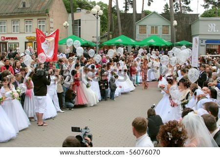JURMALA - JUNE 13: Wedding parade in resort city. Each year many brides from all country are participating in Bride parade - June 13, 2010 in Jurmala, Latvia.