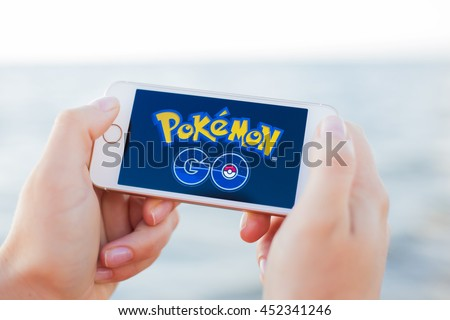 JURMALA, LATVIA - July 13, 2016: Pokemon Go logo on the phone. Pokemon Go is a location-based augmented reality mobile game. - stock photo