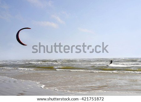Jurmala (Latvia). Surfing with a parachute (kaitserfing) in windy weather.