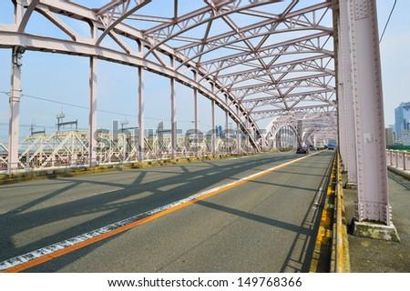 Juso-ohashi bridge in Osaka, Japan - stock photo