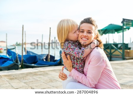 Just a little cuddle break in Venice does the body good, and makes tourism so much more fun, doesn't it? - stock photo