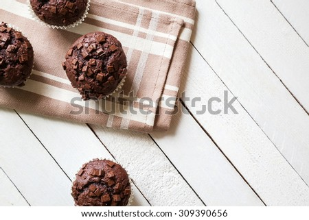 Just Baked Chocolate Muffins On Rag - stock photo