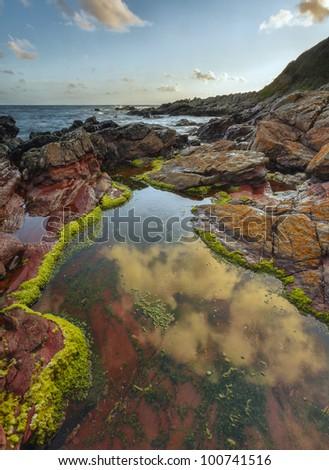 Just before sunset at Heybrook Bay, Devon, UK - stock photo