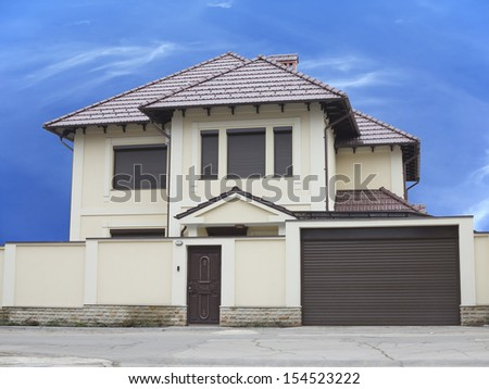 Just builded luxury house over blue sky background concept - stock photo