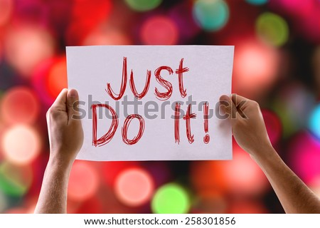 Just Do It card with colorful background with defocused lights - stock photo