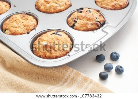 Just from oven blueberry muffins - stock photo