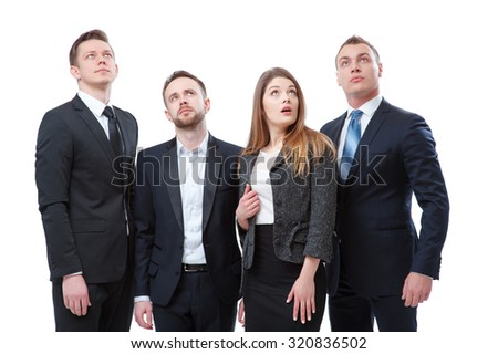 Just look at this! Group of surprised and amazed business people looking up. Isolated on white. - stock photo