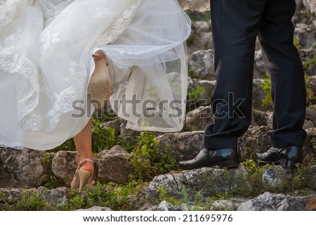 Just married couple embraced - stock photo