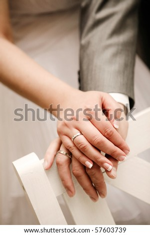 Just married couple showing up their rings - stock photo